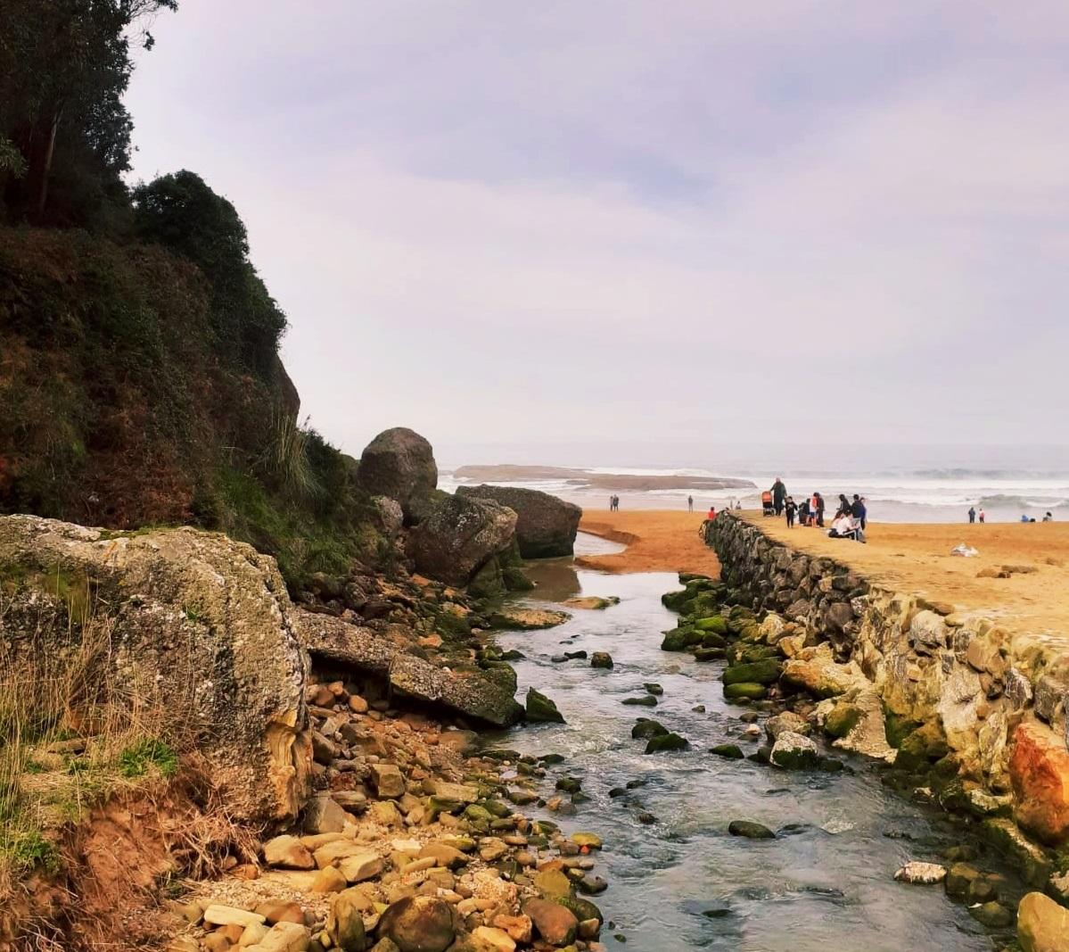 Llegada del río a la Playa.
